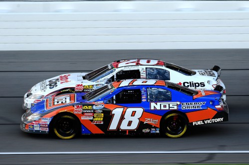 2010-Kansas-Oct-NNS-Kyle-Busch-Joey-Logano-racing-action